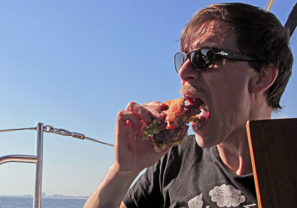 andrea belfi chowing burger on 'the sandbar' off biloxi, ms on october 26, 2014