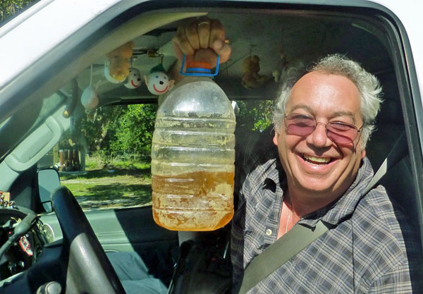 watt in the boat w/his piss jug in waldo, fl on october 25, 2014 - photo by bill bryson