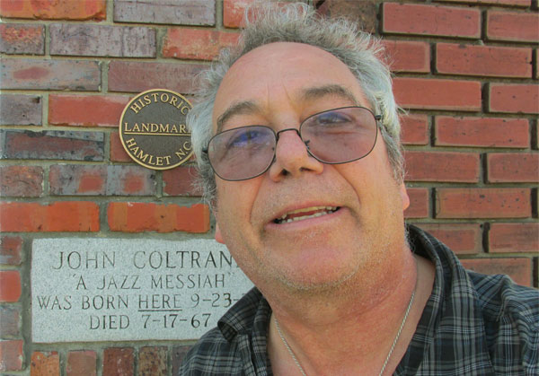 mike watt in front of john coltrane's birthplace in hamlet, nc on october 22, 2014