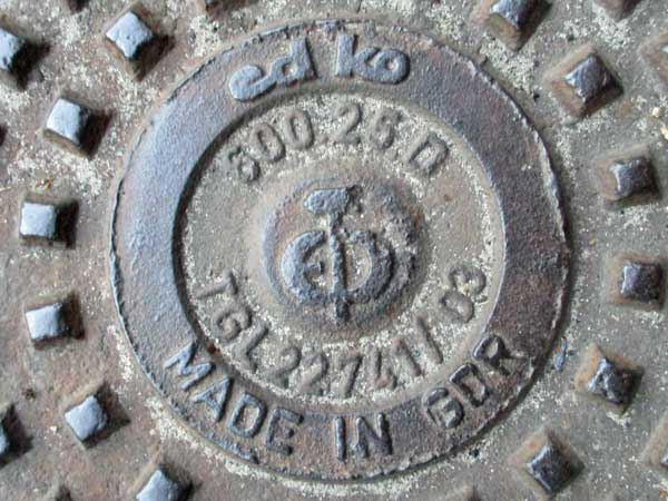 ddr era manhole cover outside andrea belfi's prac pad in the rummelsburg part of berlin, germany on september 27, 201
