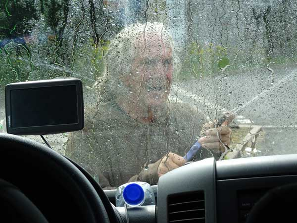 ted falconi cleaning the windshield at a fuel stop near tebay, england on august 3, 2019