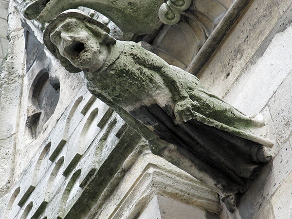 non-devil gargoyle on cathedral notre dame on august 23, 2011