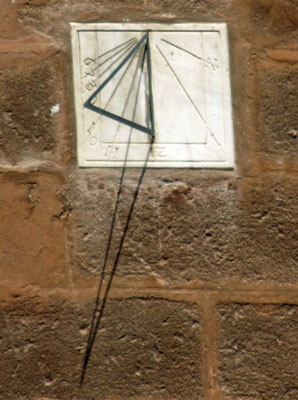 sundial on the side of saint mary's cathedral in seville, spain
