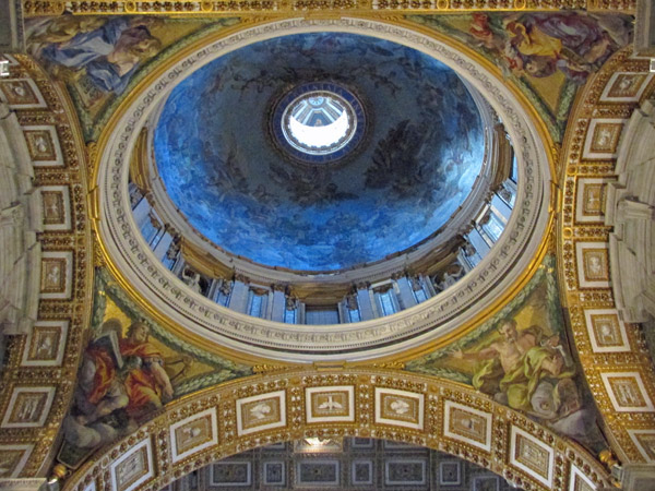 looking up at cupolo inside saint peter's basilica, vatican - july 3, 2013