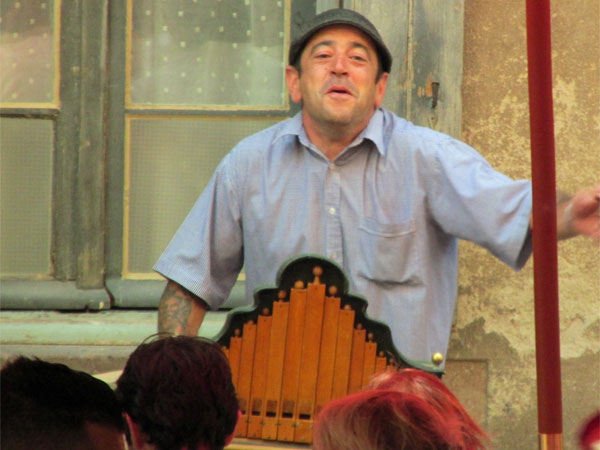 organ grinder man in albi, france - july 7, 2013