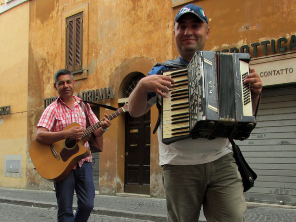 street musicians near vatican city in rome - july 3, 2013