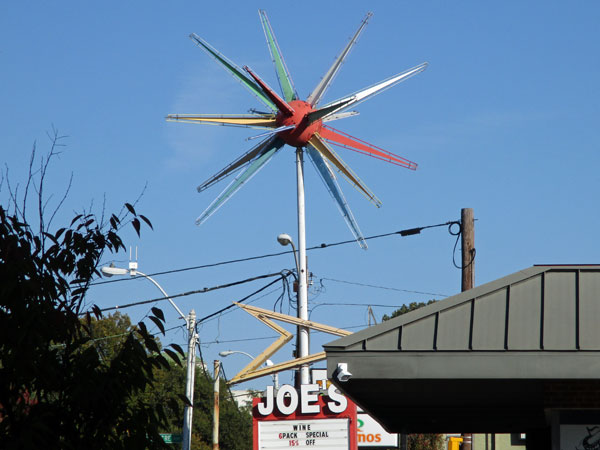 sign for 'joe's wines' near 'martin music' in memphis, tn on october 19, 2015