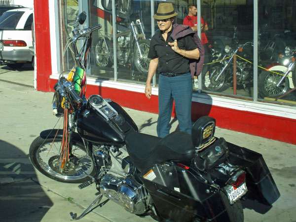 tav falco outside century motorcycles in san pedro, ca on october 30, 2015