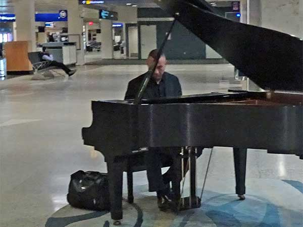 piano player in the baggage area of the minneapolis airport on march 25, 2019