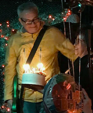 concepcion tadeo giving mike watt a cake on his 60th bday at 'bottom of the hill' in san francisco, ca on december 20, 2017